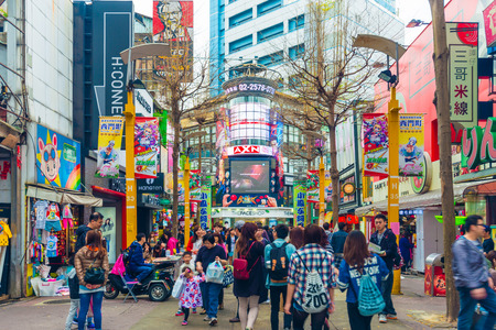 TAIPEI, TAIWAN - MARCH 2015 : Locals and tourists walking at the Ximending street market in Taipei, Taiwan on March 21, 2015. This street is full of food stalls, shops, cafes, restaurants.