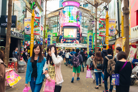 locals: TAIPEI, TAIWAN - MARCH 2015 : Locals and tourists walking at the Ximending street market in Taipei, Taiwan on March 21, 2015. This street is full of food stalls, shops, cafes, restaurants.