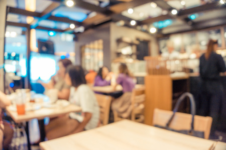 blurred restaurant background, People in Coffee shop blur background with bokeh