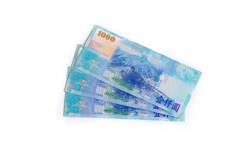 New Taiwan Dollar cash isolated on white backuground close up