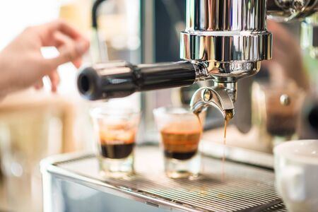 Coffee machine prepares espresso in coffeeshop, close-up