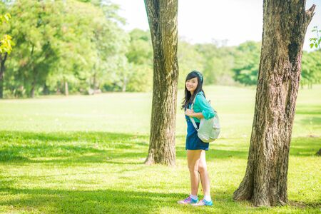 knapsack: Woman in park outdoor with knapsack, Beautiful woman in the park