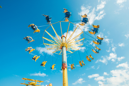 chain swing ride: People funny with swing ride at fair blue sky, Hongkong ocean park