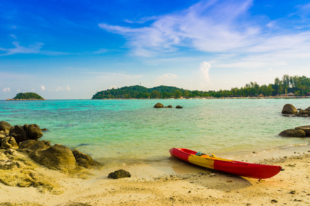 Red yellow kayaks on the tropical beach, Lipe island, Thailand Stock Photo