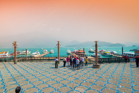 ridgeline: SUN MOON LAKE - MARCH 20: Boats parking in morning at the pier on March 20, 2015 at Sun Moon Lake, Taiwan. Sun Moon Lake is the largest body of water in Taiwan as well as a tourist attraction.