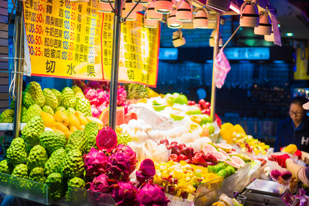 taiwanese: TAIPEI, TAIWAN - MARCH 21, 2015: Food vendors operate at a night Market on Guangzhou Street. Night markets are a popular part of Taiwanese culture.
