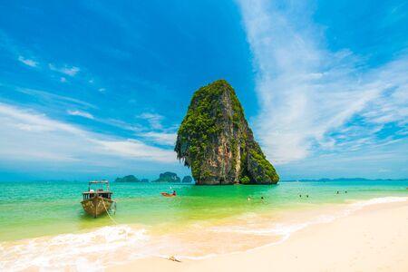 railay: Longtail Boat on railay beach with island in Krabi, Thailand