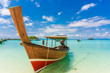 longtail: Longtail wood boat and islands in andaman sea, Thailand