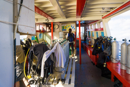 diving equipment: Set of diving equipment on the boat and Oxigen tanks for scuba diving
