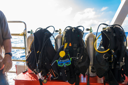 diving equipment: Scuba Diving kit set up ready for dive, Diving equipment on the boat Editorial