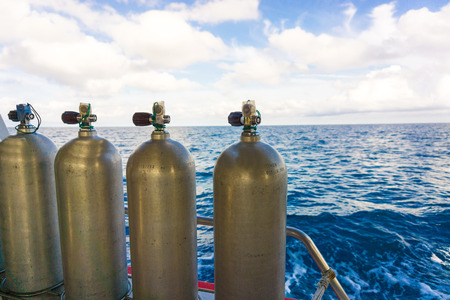 diving equipment: Oxigen tanks on boat for scuba diving, Diving equipment