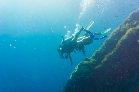 scuba diver: Scuba Diver on coral reef in clear blue water, Diving at South West Pinnacle on Koh Tao, Thailand Stock Photo