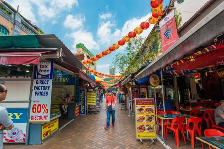 historically: SINGAPORE - MARCH 6: Singapores Chinatown, an ethnic neighborhood featuring Chinese cultural elements and a historically concentrated ethnic Chinese population on March 6, 2015.