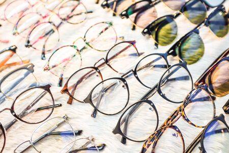 Row of glasses at an opticians, sunglasses background Archivio Fotografico