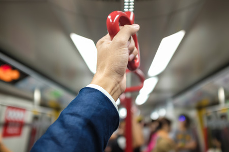transportaion: Business hand hold bus or train handle bar, Handrails