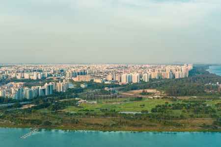 Landscape from bird view of Singapore skyline with city, over the Garden by the bay in Marina bay sand