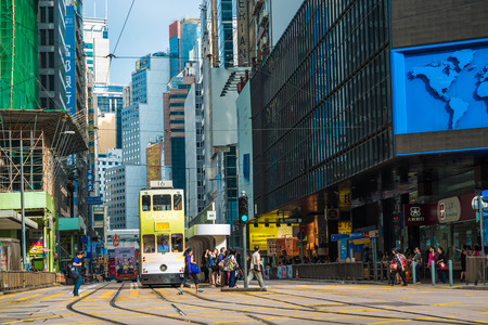 trams: HONG KONG - OCT 25: Double-decker trams. Trams also a major tourist attraction and one of the most environmentally friendly ways of travelling in Hong Kong on October 25, 2015 in Hong Kong.