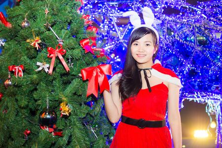 Asian women  wearing santa claus clothes with tree, christmas and celebration Stock Photo