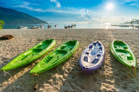 ocean kayak: Kayak boat at the tropical beach, Colorful kayaks blue sky Foto de archivo