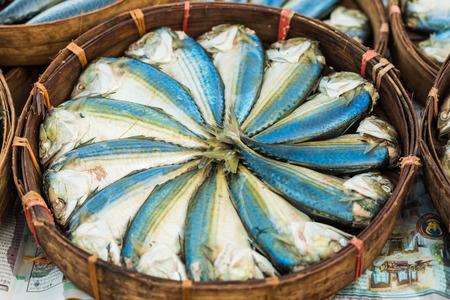 Mackerel fish in basket at market, seafood market.