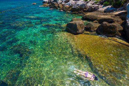 koh tao: Woman swimming in the crystal sea, Koh Tao,Suratthani  Thailand Stock Photo