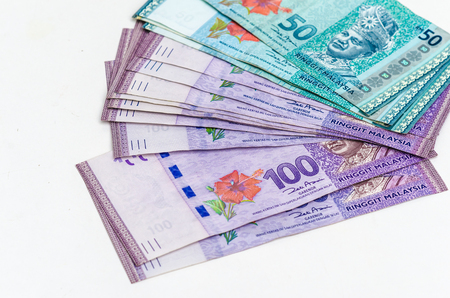 global rates: Malaysia money on the white background. Close up