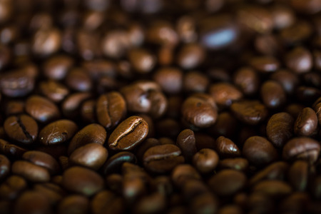 def: Selective focus of brown roasted coffee bean, Dept of field close up techniq