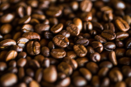 Selective focus of brown roasted coffee bean, Dept of field close up techniq