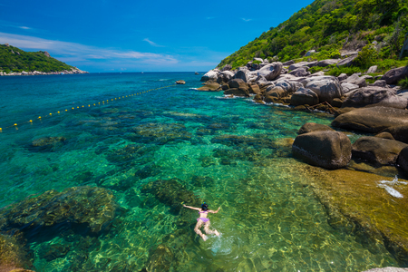 Woman snorkeling in clear sea, Vacation time