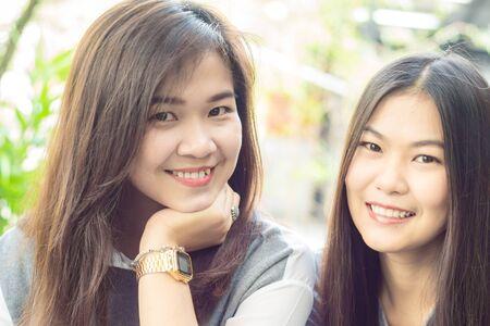 Two asian beautiful women Sitting Outside House, Close up