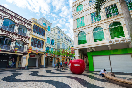 st  francis: MACAU, CHINA -OCT 22: Visitors on famous souvenir street in Macau on October 22, 2015. Chinese tourists are the main resource in Macau tourism industry now.