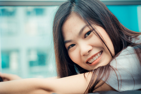 wellness sleepy: Fashion photo of beautiful young asian woman lying on the bed in condominium lodern living Stock Photo