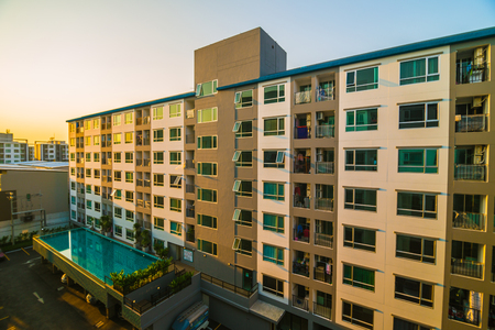 new car lots: Condominium residential block building in evening