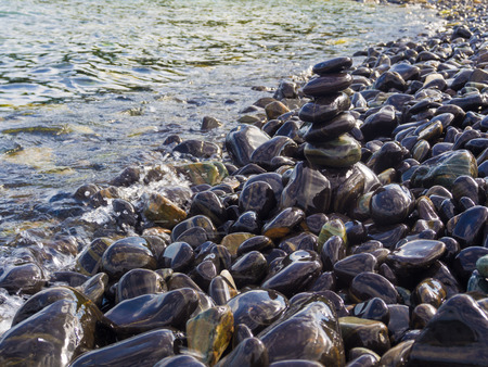 smooth stones: Stack of smooth stones on a seashore, Beach and rock stack