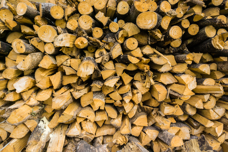 kindling: Stack of dry firewood in a pile for furnace kindling