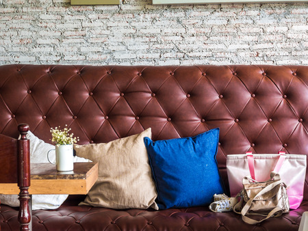 luxurious sofa: Vintage retro sofa chair with white brock wall in coffee shop, cafe Stock Photo