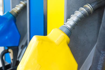 litre: Colorful fuel oil gasoline dispenser at petrol filling station, Close up Stock Photo