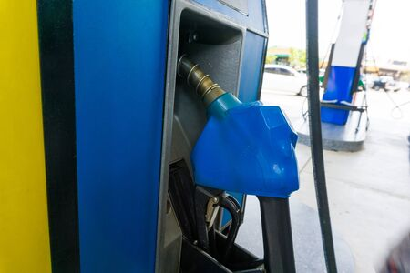 energize: Gasoline Pump nozzles at the gas station
