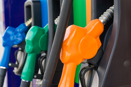 unleaded: Close up of colourful fuel pumps at a gas station.
