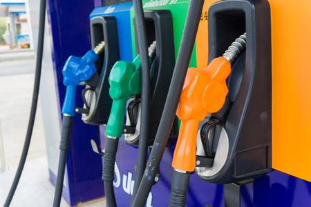 fuel pumps: Close up of colourful fuel pumps at a gas station.
