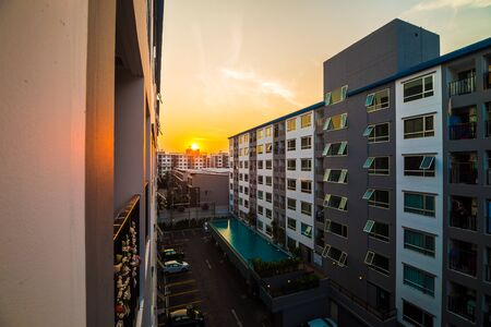 new car lots: Condominium estate with sunset in the center of bangkok,  Thailand. Stock Photo