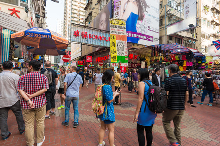 characterized: HONG KONG - OCT 23: Mong kok at day on October 23, 2015 in Hong Kong. Mong kok is characterized by a mixture of old and new multi-story buildings with shops and restaurants. Editorial