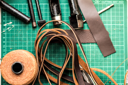 Working space background with leather camera strap using crafting DIY tools Stock Photo