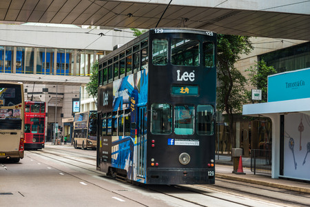 doubledecker: HONG KONG - OCTOBER 25, 2015: Hong Kong double-decker tram in Central. Trams in Hong Kong is the cheapest mode of public transport on the island Editorial