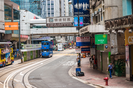 cheapest: HONG KONG - OCTOBER 25, 2015: Hong Kong double-decker tram in Central. Trams in Hong Kong is the cheapest mode of public transport on the island Editorial