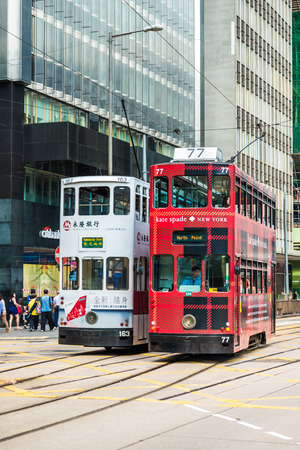 mode transport: HONG KONG - OCTOBER 25, 2015: Hong Kong double-decker tram in Central. Trams in Hong Kong is the cheapest mode of public transport on the island Editorial