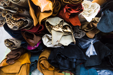 cuero vaca: Colourful genuine cow leather on shelf in shop material used for shoe, bag, wallet etc product
