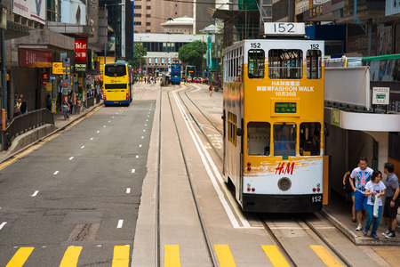 hongkong: HONG KONG - OCTOBER 25, 2015: Hong Kong double-decker tram in Central. Trams in Hong Kong is the cheapest mode of public transport on the island Editorial
