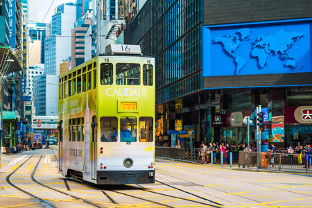 tramcar: HONG KONG - OCTOBER 25, 2015: Hong Kong double-decker tram in Central. Trams in Hong Kong is the cheapest mode of public transport on the island Editorial
