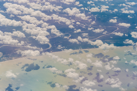 nebulosity: blue sky background with tiny clouds, View from above airplane